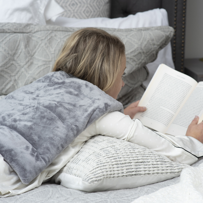 woman laying down reading