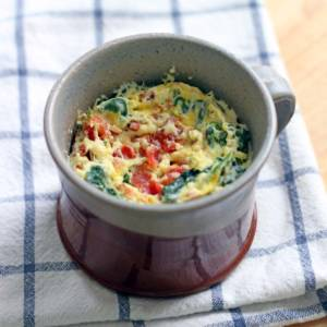 Spinach and cheddar microwave quiche in a mug